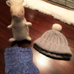 Knitted hat and socks with squirrel stuffed animal