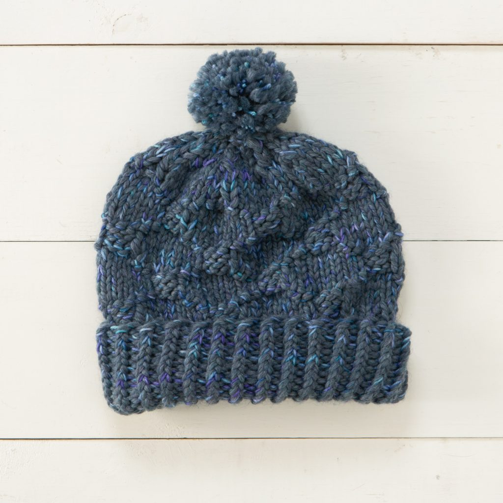 Baltimore Hat knit in Biggo and Capretta Handpaint Superwash Special Reserve yarns - Staff Project.