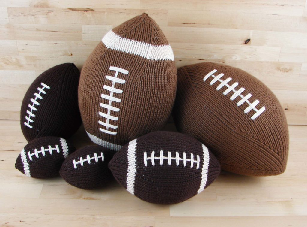 A pile of knitted footballs looks like fun! Stuffed Footballs: A new indie knitting pattern available at knitpicks.com.